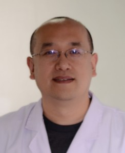 Dr. Yu in lab coat